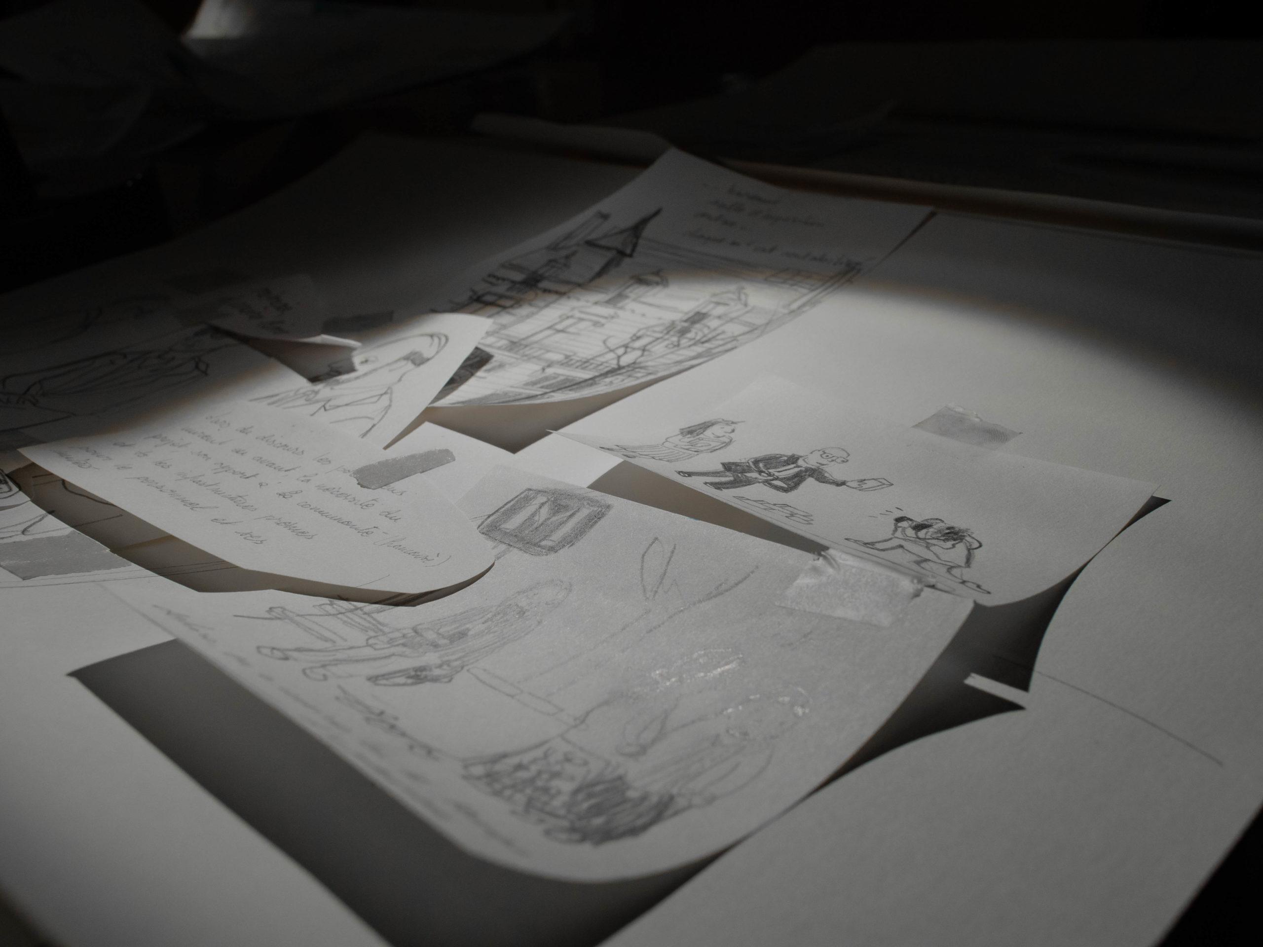Travail sur le scénario et la mise en place de dessins sur la table de travail