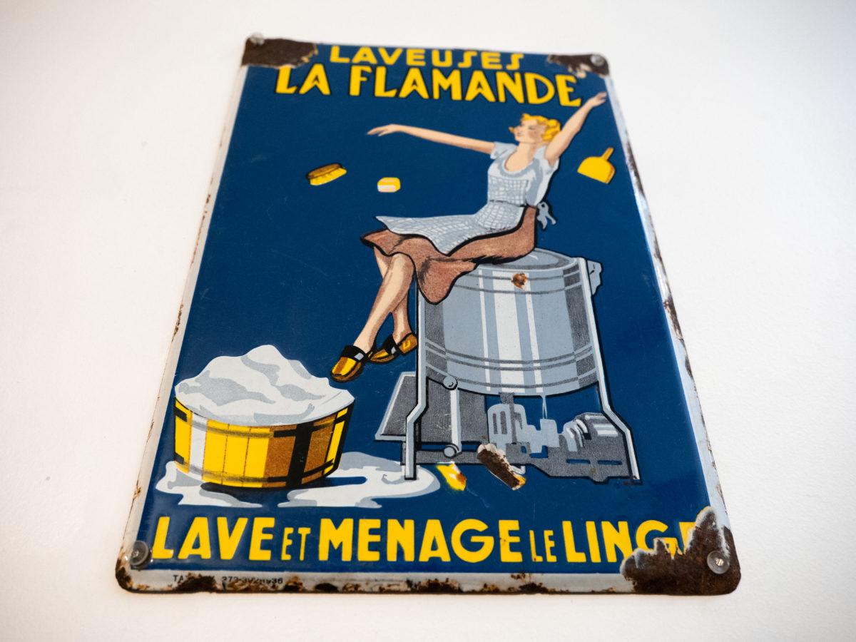 """Plaque émaillée publicitaire pour la machine """"laveuse la flamande"""""""